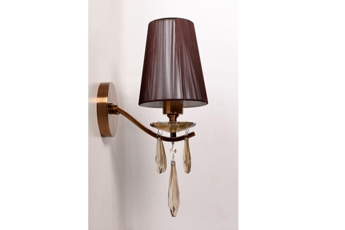Applique lampada da parete con braccio in cristallo alessia w ottone